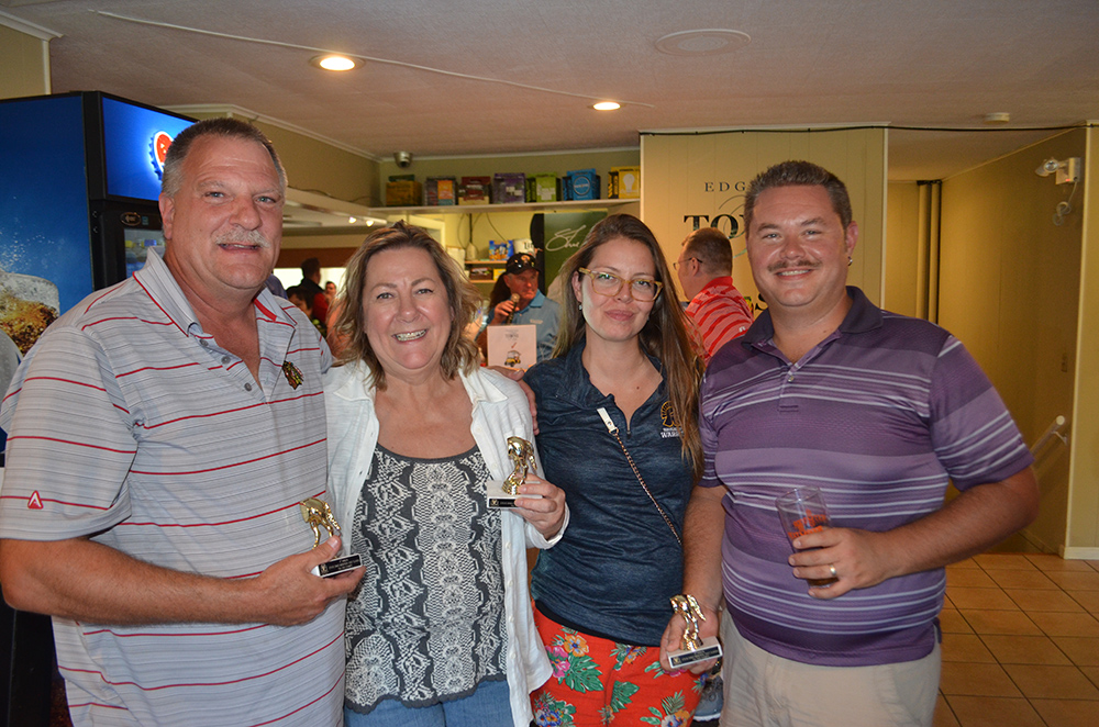 Four Rhyme Employees in the clubhouse after the Steve Ennis Memorial Golf Classic